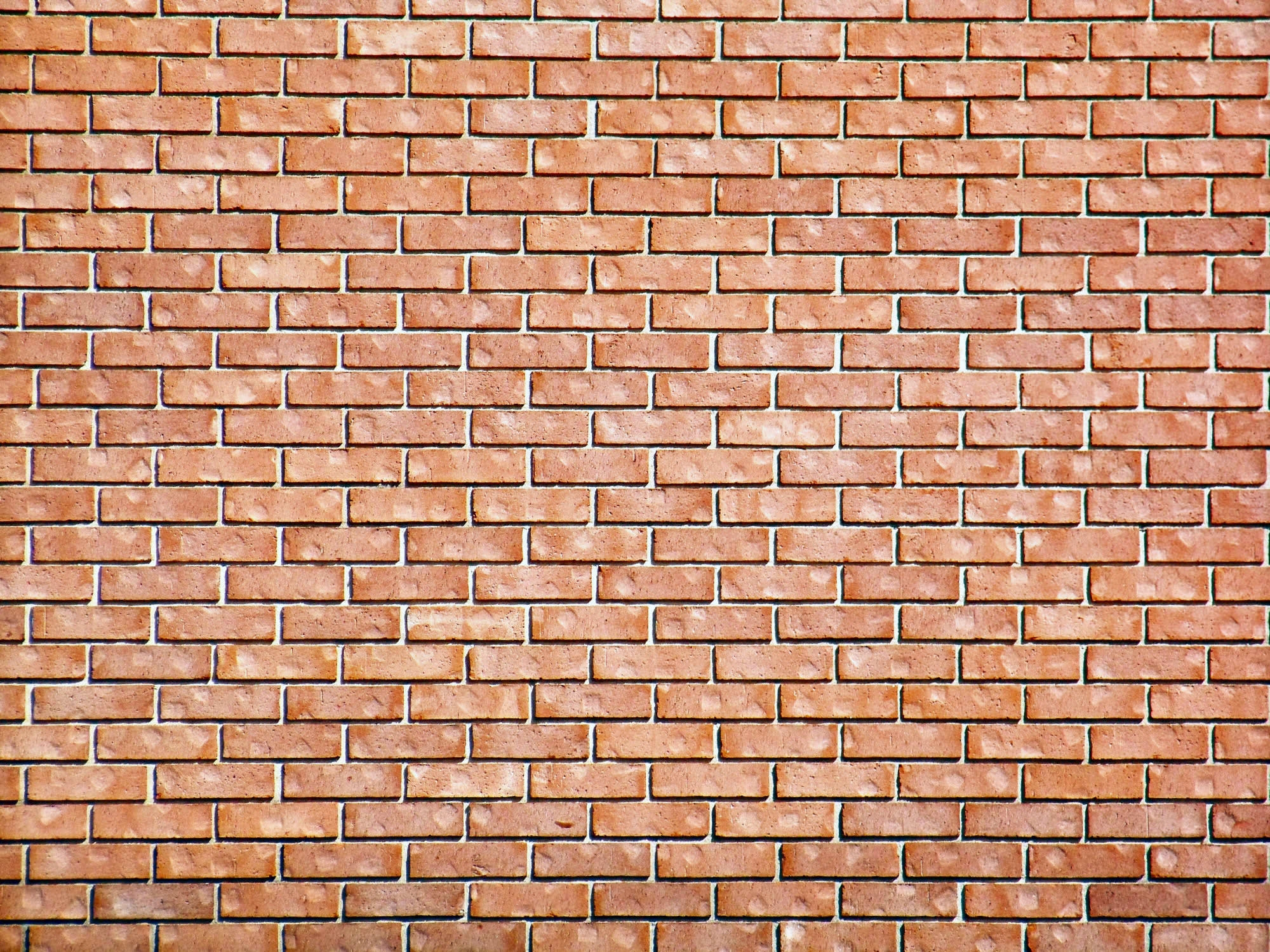 35 brick wall backgrounds images pictures freecreatives for Wallpapering a wall
