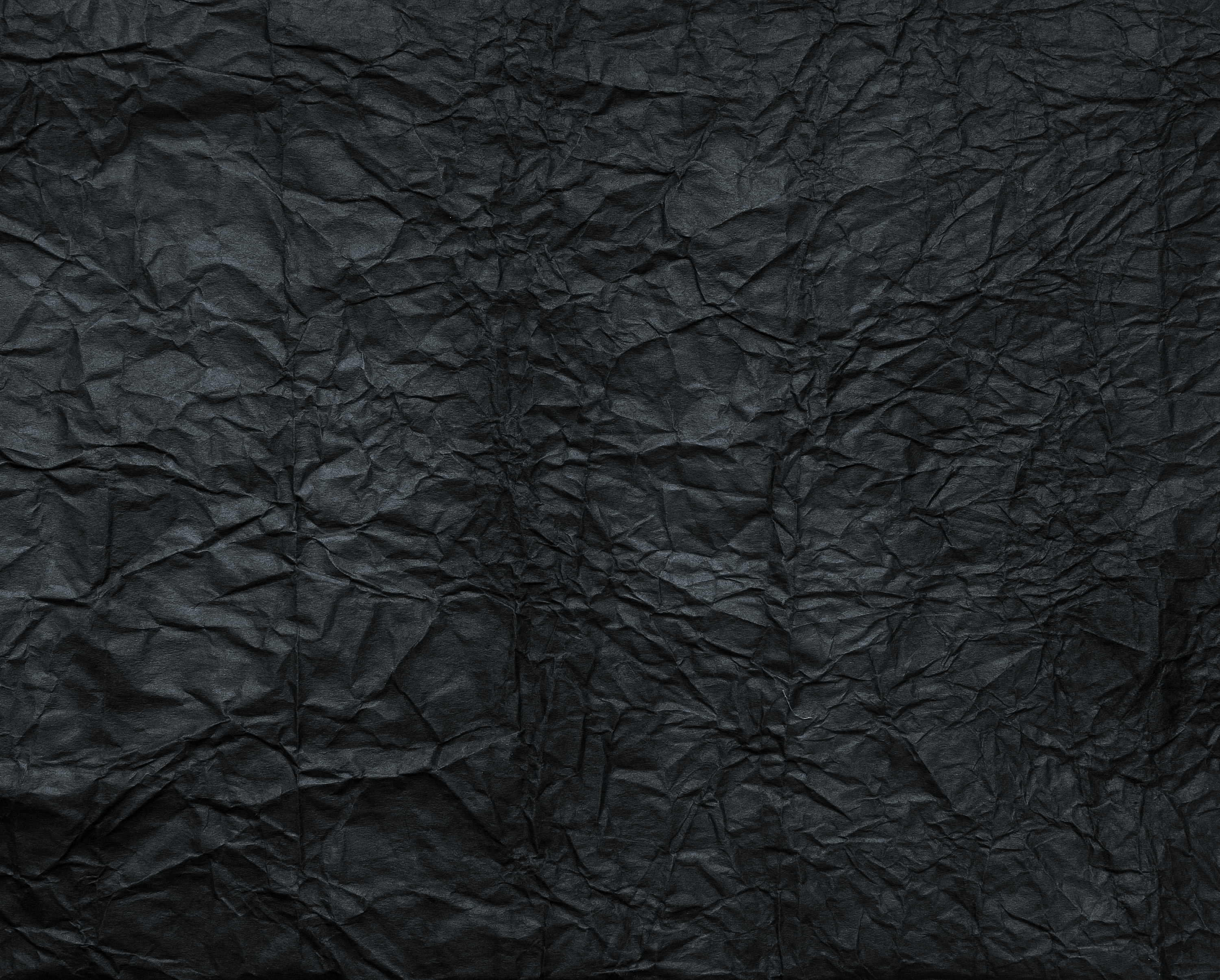 wildtextures-creased-black-paper-texture