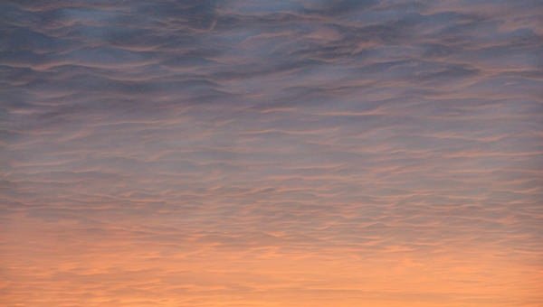 pleasant sunset sky texture with orange clouds