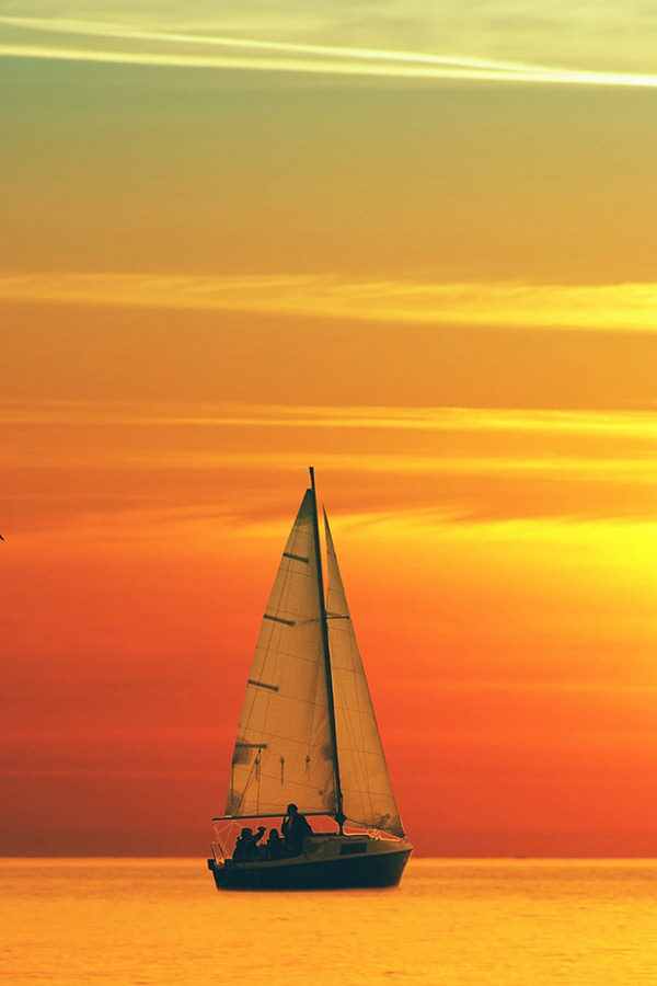 Boat Sailing at Sunset iPhone 4s Background