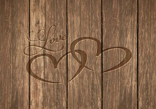 Free Vector Heart Carved on Wooden Table