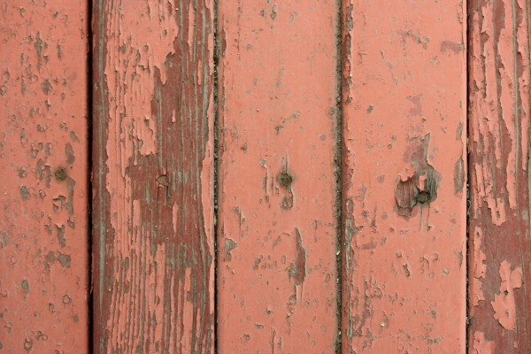 Peeling Red Paint on Old Wooden Board Texture