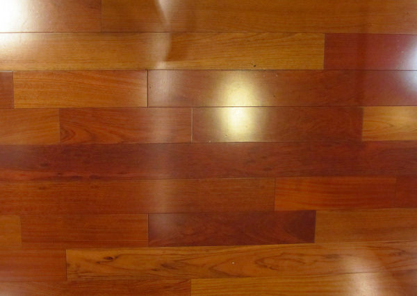 Red Wood Texture with Bright Plank Cherry Flooring Reflection