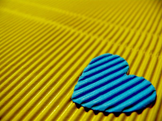 Blue Heart on a Yellow Background