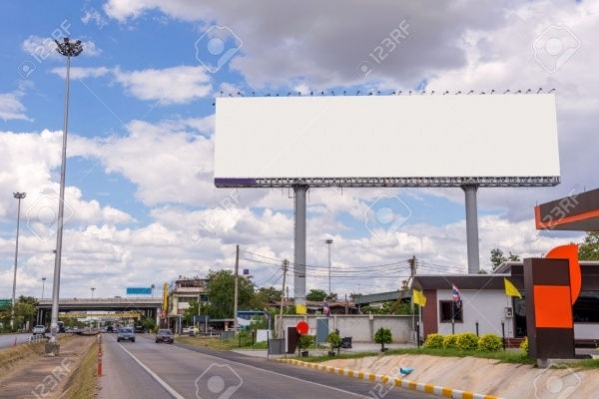 large blank billboard on road with city view background1