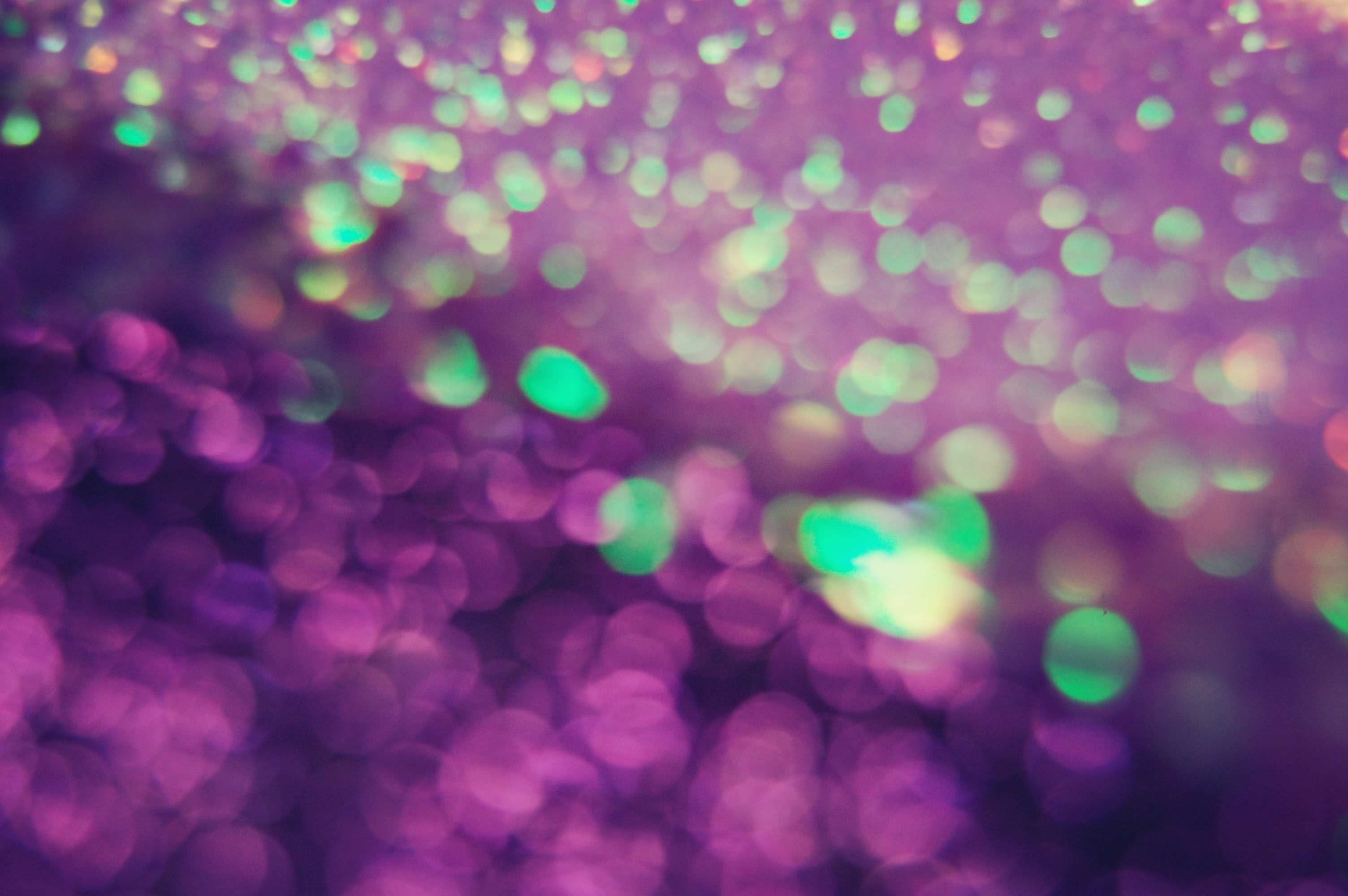 Purple Glitter Bokeh Background
