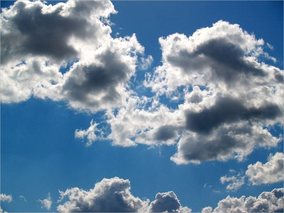 White Clouds in Blue Background