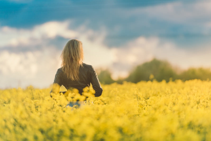 Woman in Yellow Flower Feild Background