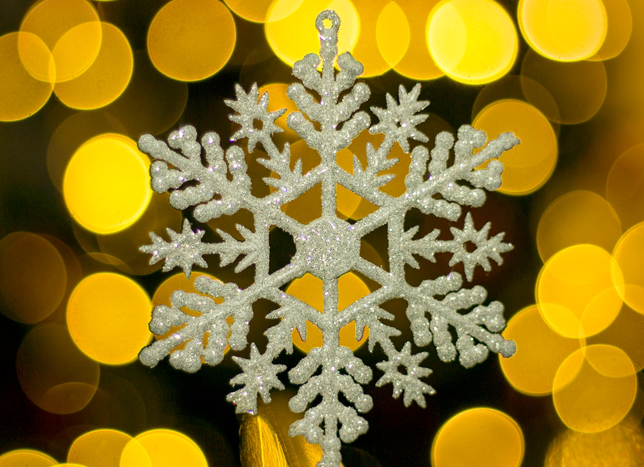 Yellow Snowflakes Bokeh Background