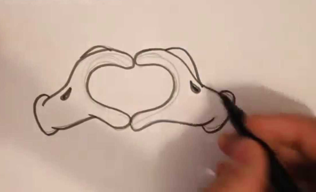Love Shape with Hands Drawing