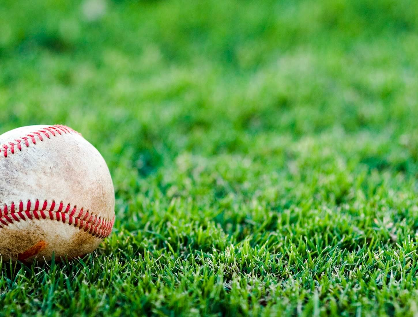 Baseball on Green Grass Wallpaper