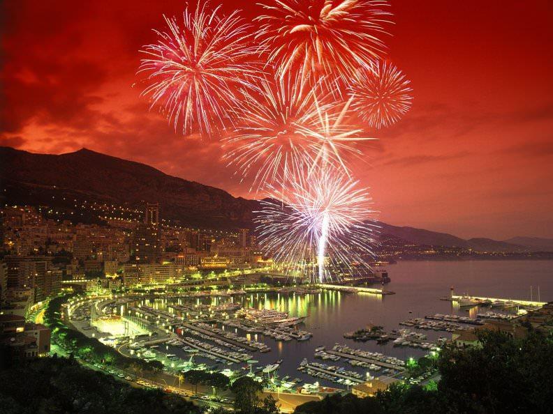 Fireworks Over Coastal City Wallpaper