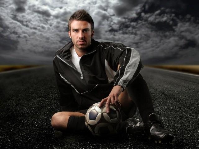 Footballer on the Road Background