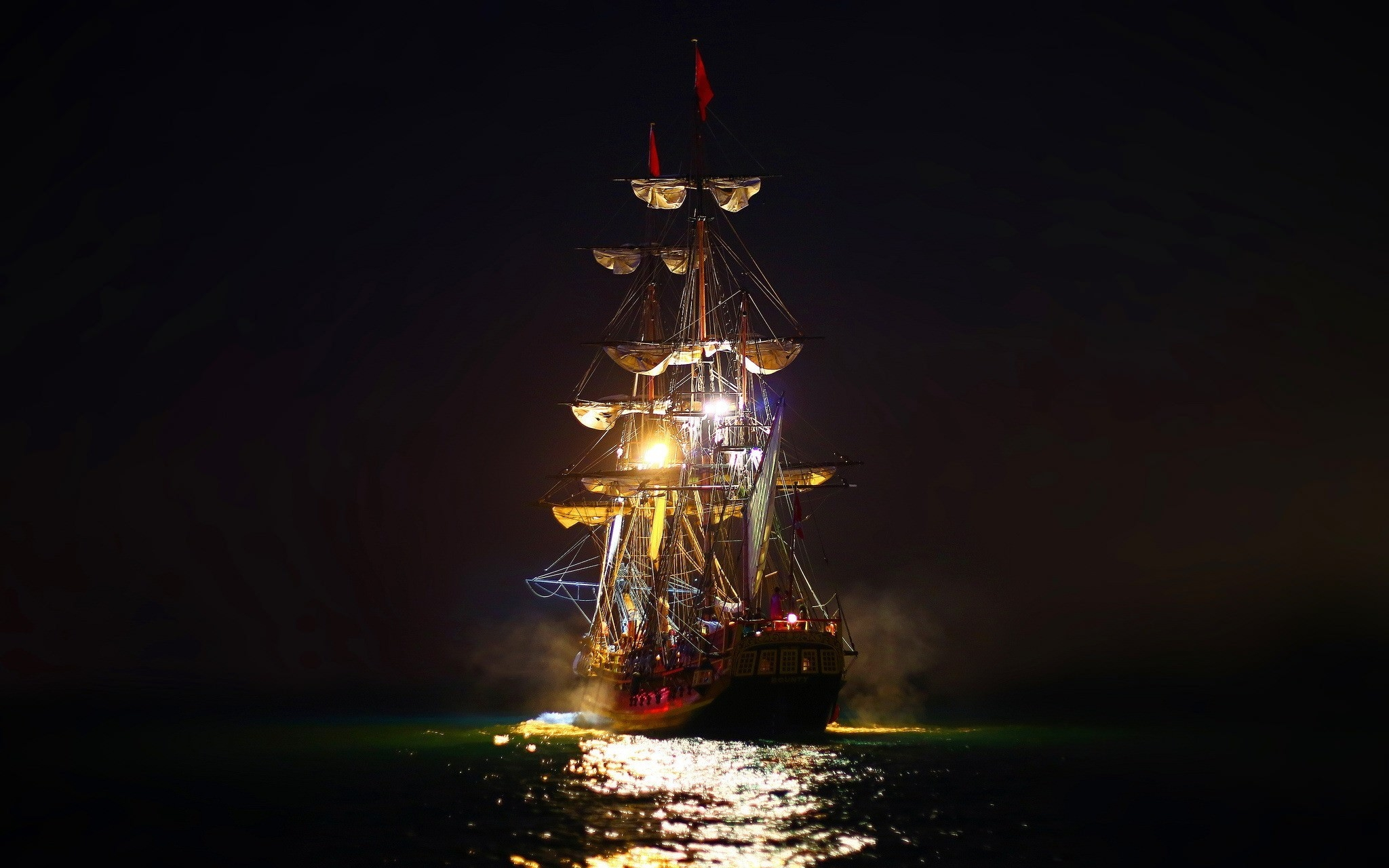 Sailing at Night Wallpaper