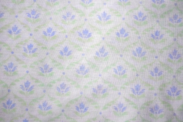 White Fabric with Blue Floral Pattern Texture Background