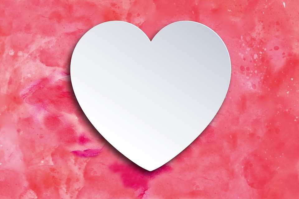 White Heart on Pink Background