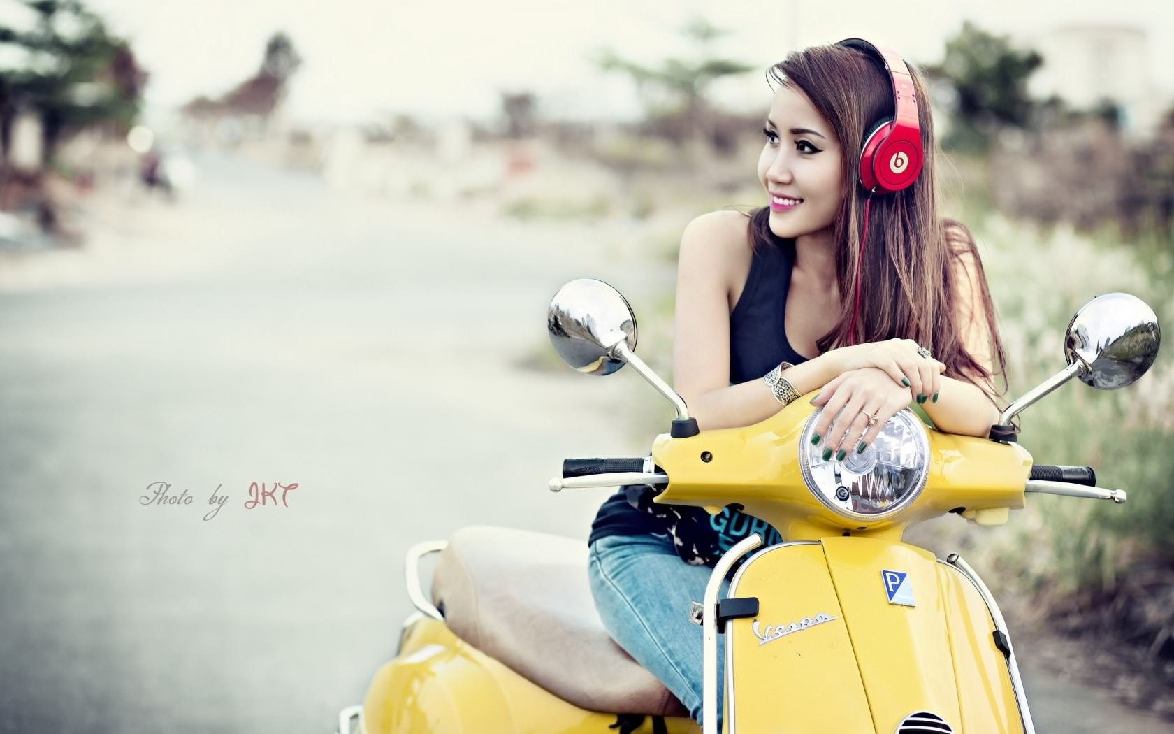Asian Girl Smiling on Scooter with Headphones