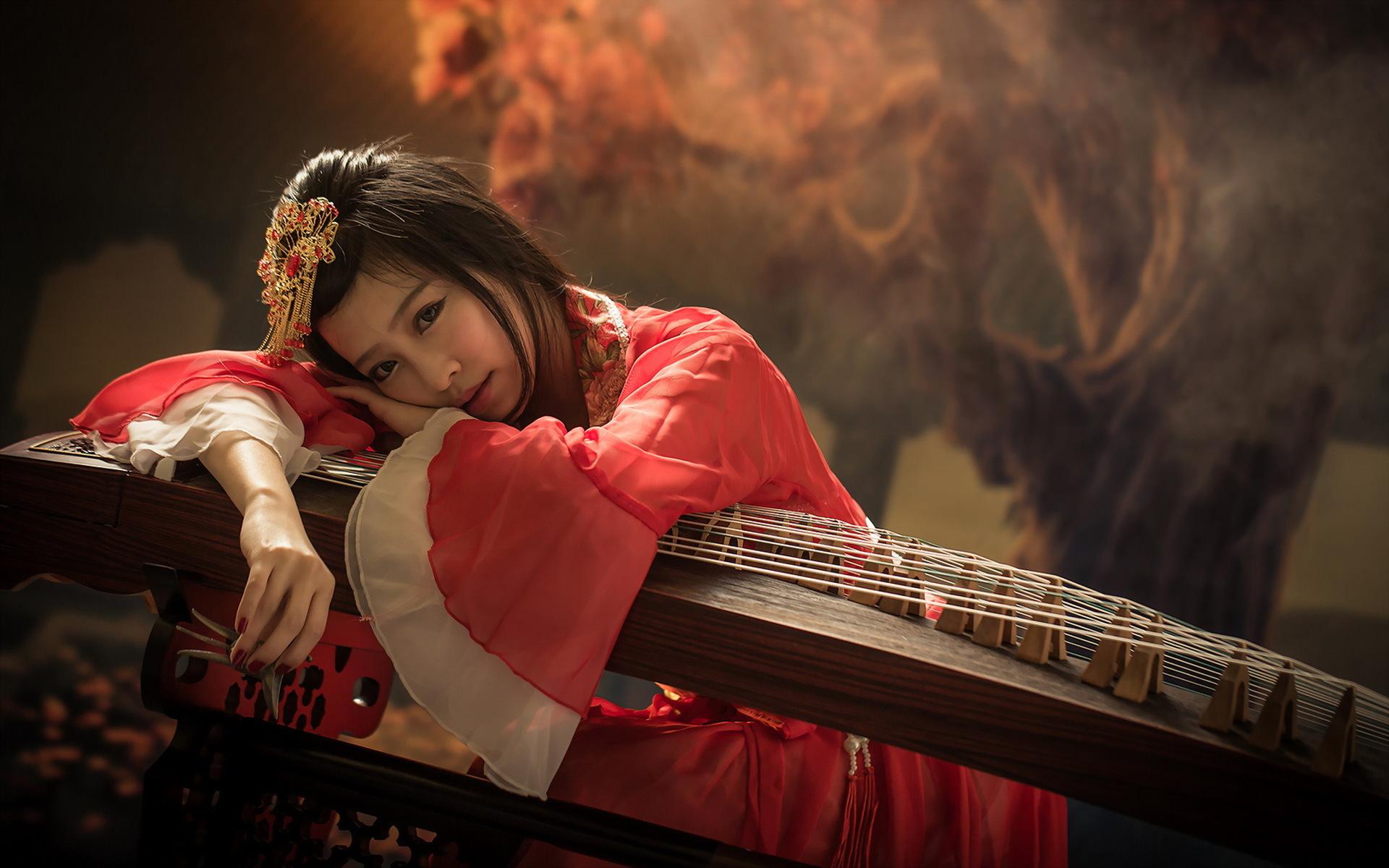 Asian Women on Musical Instrument