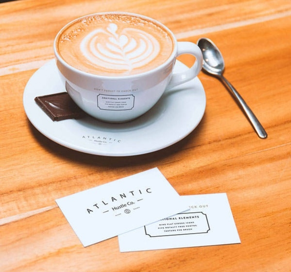 Free Business Cards and PSD Coffee Cup Mockup on Table