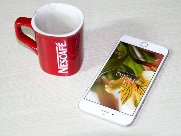 Free PSD iPhone 6 and Nescafe Coffee Cup Mockups in 4 Colors