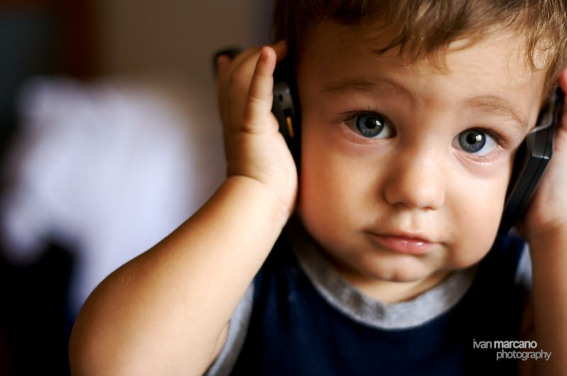 Kid With Headphones Photo