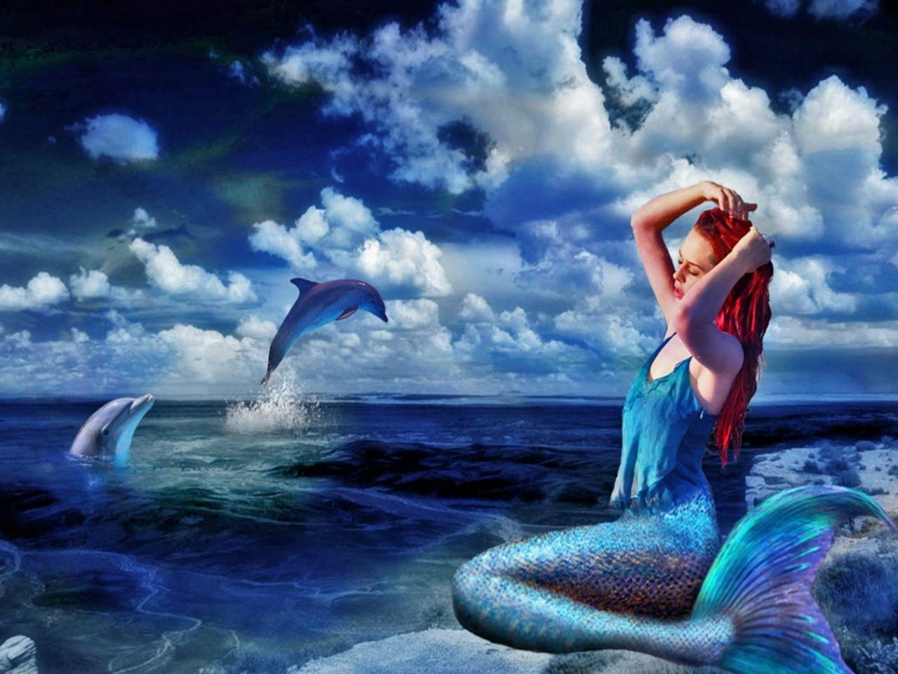 Mermaid Chilling With Dolphins Wallpaper