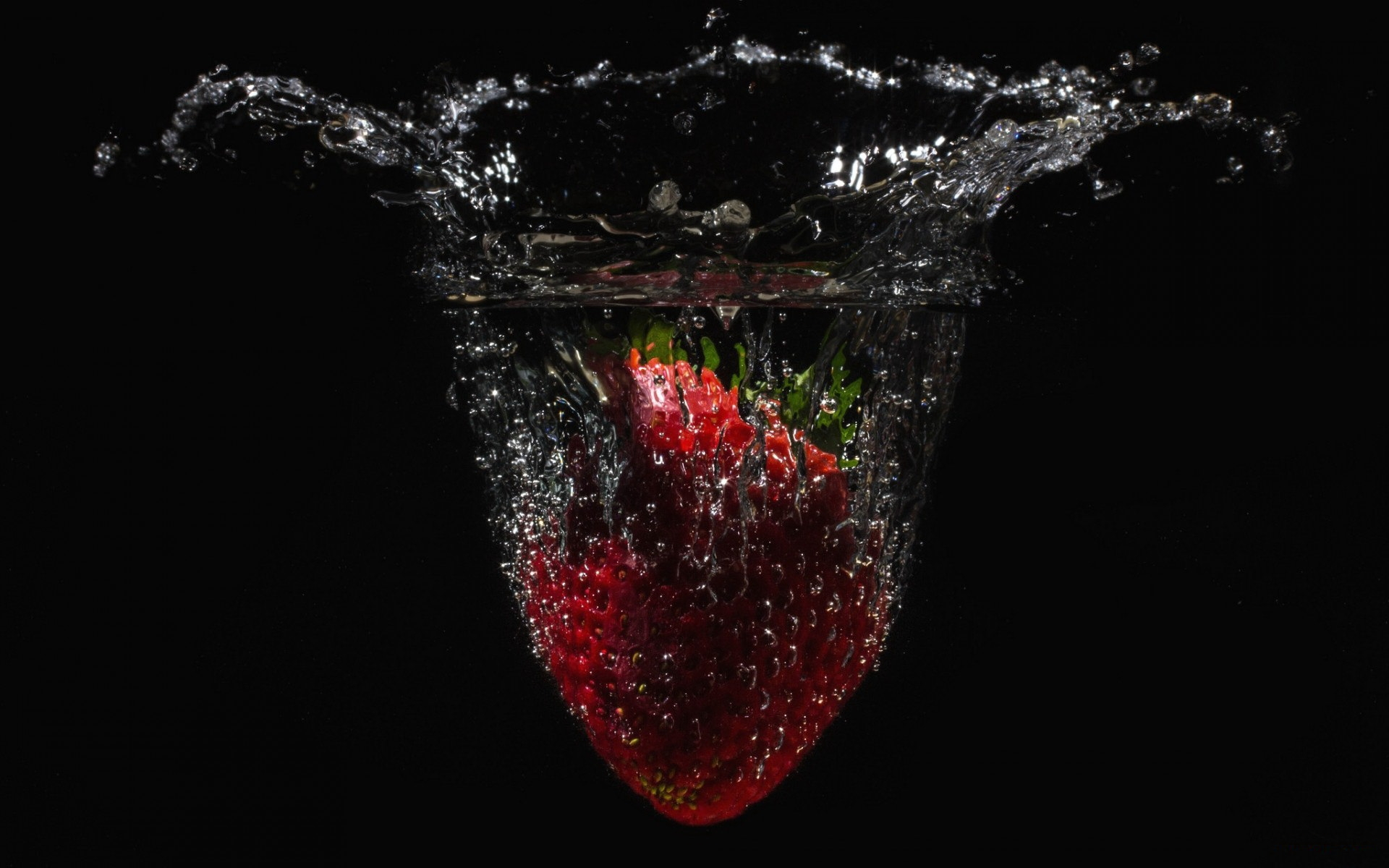 Strawberry In Water Glass