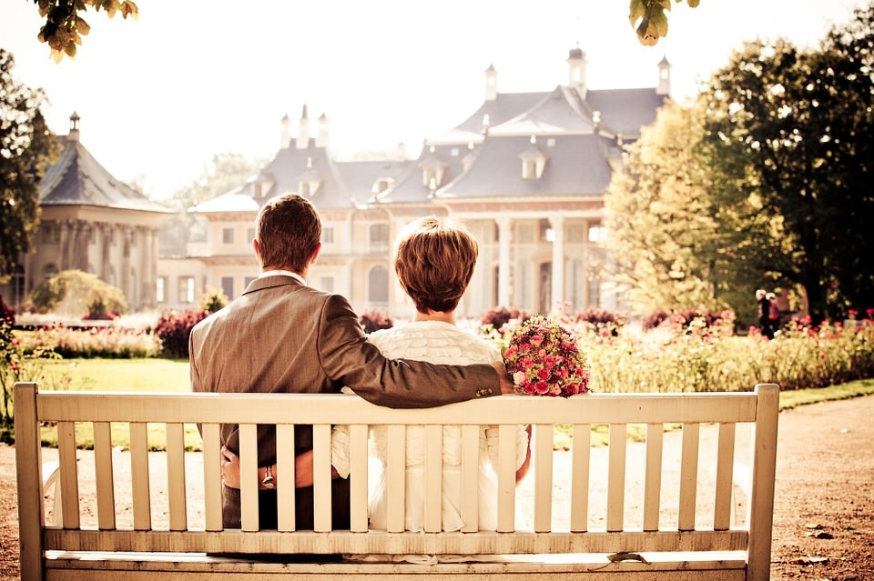 Wedding Couple on Bench Background