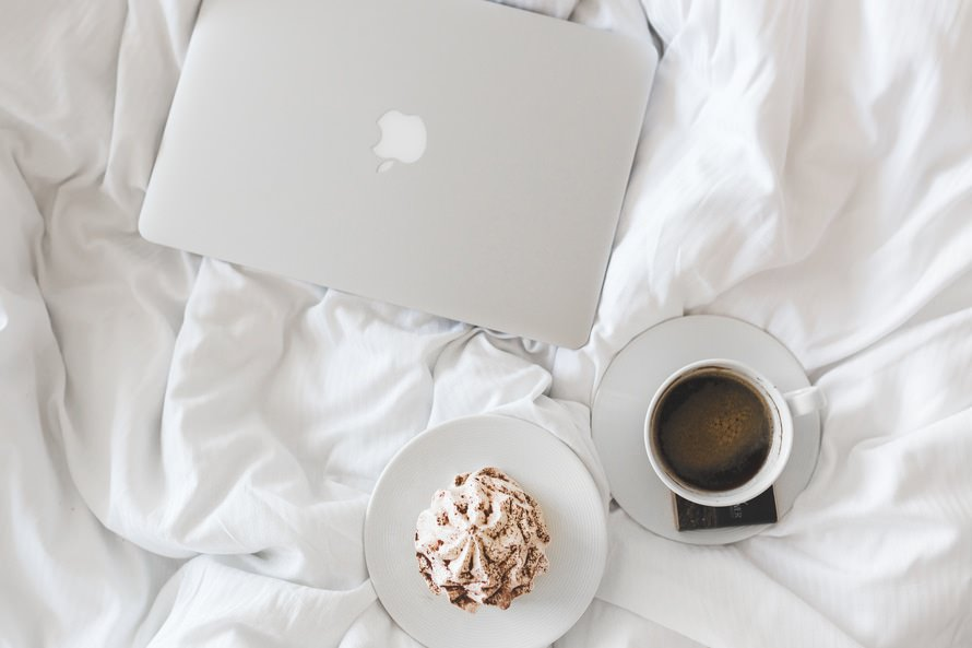White Macbook with Coffee Wallpaper