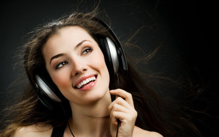 woman listening to music in headphone