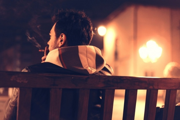 person sitting lonely smoke photography