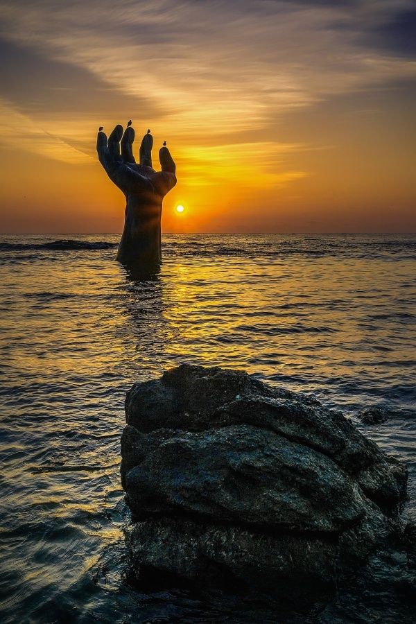 Hand In Sea Sunrise Photography