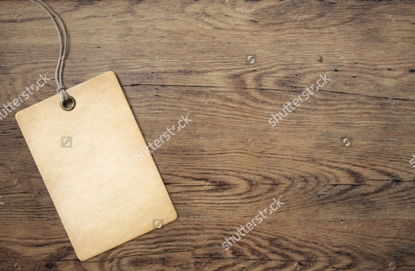 Cardboard Tag On Wooden Background