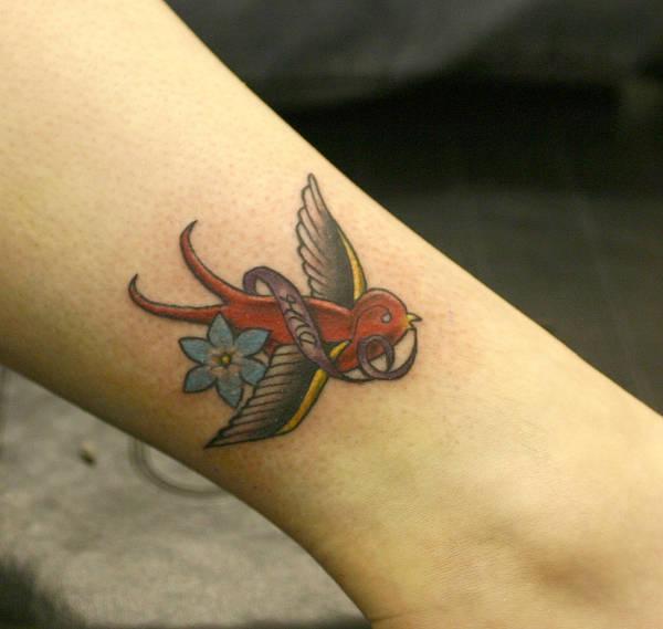 Small Bird Tattoo Design