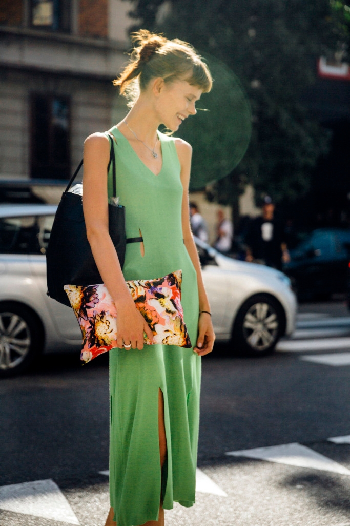 Ukrainian model Irina Kravchenko exits the Etro show during the Milan Fashion Week Spring/Summer 16 on September 25, 2015 in Milan, Italy. Irina wears a lime green dress by Ukrainian designer Rito. She carries an Etro print pillow and black tote bag.