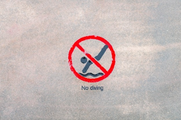 no-diving-warning-sign-at-the-poolside_1232-3427